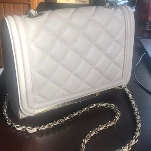 Light pink cross body purse from Aldo.
